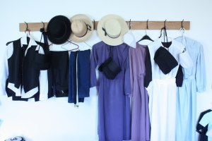 Amish clothing hanging on wall