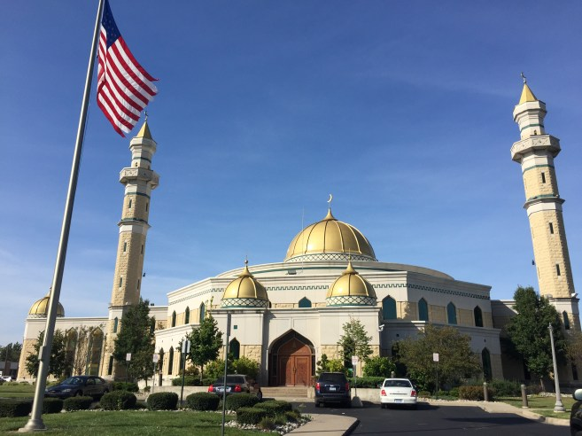 mosque with American flag flying in front