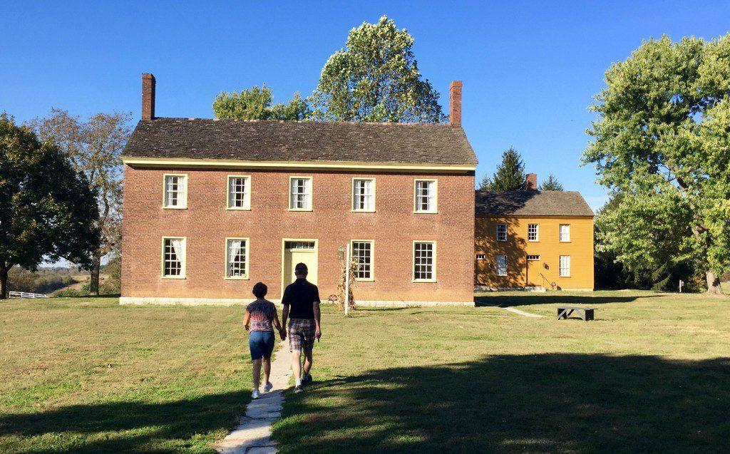 Shaker Village scene with tourists