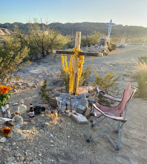 chair next to a grave in Terlingua, Texas, cemetery