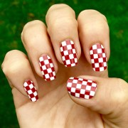 crimson & white checkered nail