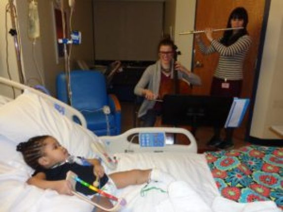 At the bedside of a patient at La Rabida Children's Hospital (Photo: Courtesy of Sharing Notes)