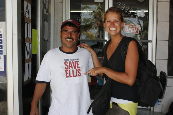 Ellis on Roatan Island in Honduras, pointing at a guy with ´Save Ellis´ on his t-shirt