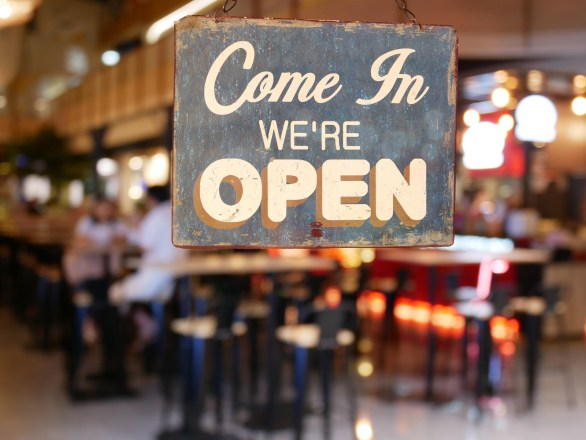 A business vintage sign that says 'Come in We're Open'