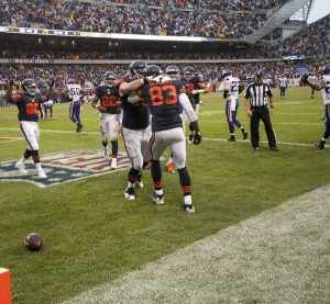 The Bears celebrate their victory in the end zone. Photo by Steve Floyd