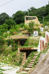 Greendo: Undulating Geothermal Homes Built Into the Side ...