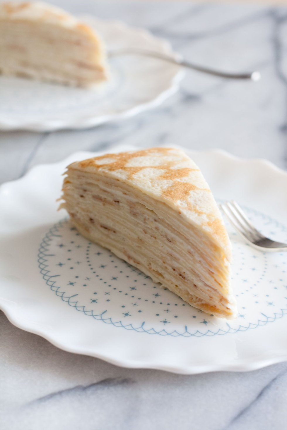 Decadent, classic French cake consisting of 14 layers of paper thin crepes separated with pastry cream, plus variations on how you can serve it in different ways just by adding 1 or 2 ingredients!
