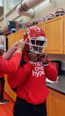 and  getting fitted for their helmets  ...