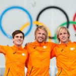 Winner of the men's 500 meters speed skating competition Mulder of the Netherlands, second placed Smeekens of the Netherlands and third placed Mulder of the Netherlands celebrate at the flower ceremony for the event at the 2014 Sochi Winter Olympics