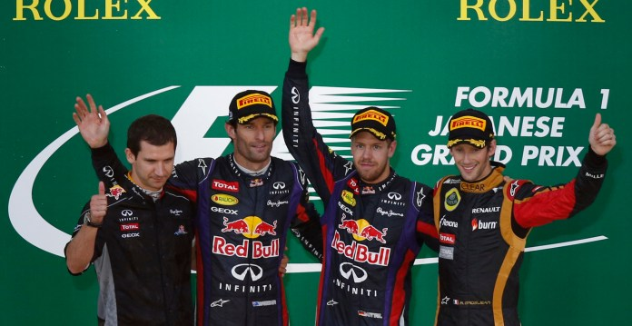 Taffin, head of Track Operations of Renault Sport F1, second-placed Webber of Australia, first-placed Vettel of Germany and third-placed Grosjean of France pose on the podium after the Japanese F1 Grand Prix at the Suzuka circuit