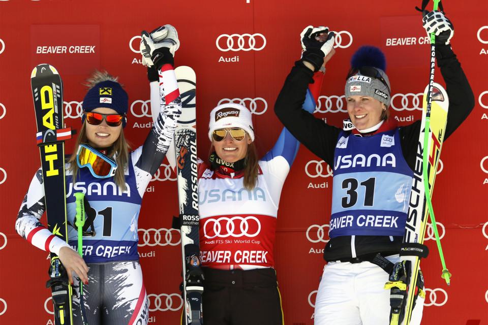Lara Gut of Switzerland celebrates on the podium after winning the women's World Cup Super-G ski race in Beaver Creek