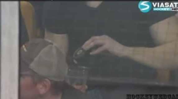 bruins-fan-beer-puck