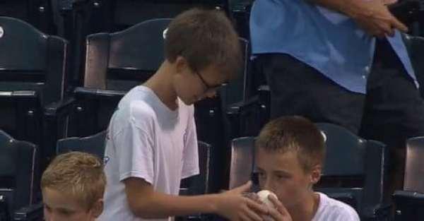 kid-smells-ball