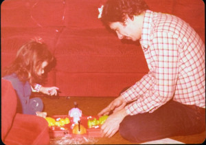 My dad, circa 1981, playing Hungry Hungry Hippos with my sister.