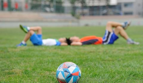 football players lying down