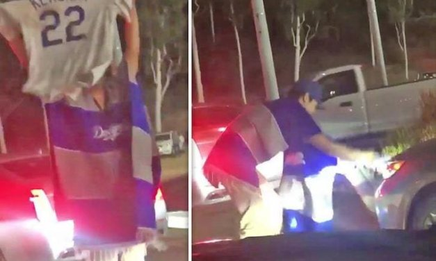 Video surfaces of Dodgers Fans Driving Over Clayton Kershaw Jersey