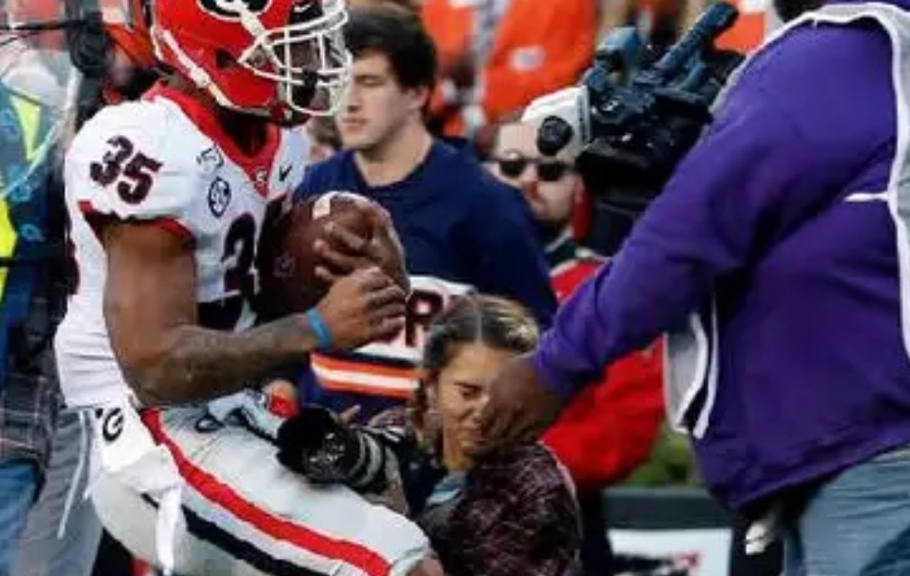 Female Photographer Knocked Out During Georgia-Auburn Game Provides a Positive Update