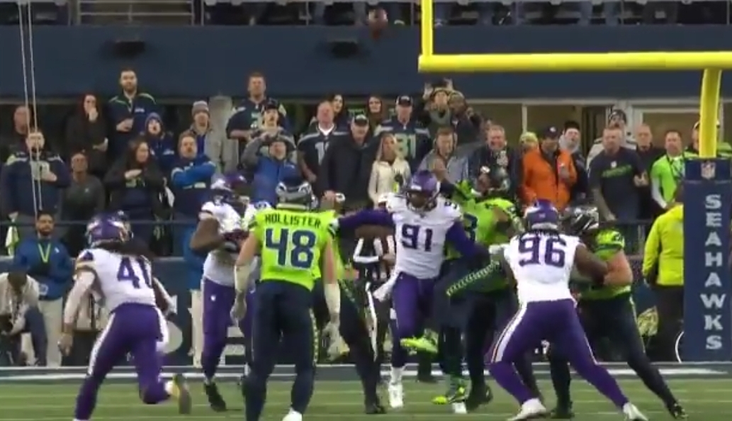 Russell Wilson Throws an Insane Batted Ball Pick Six