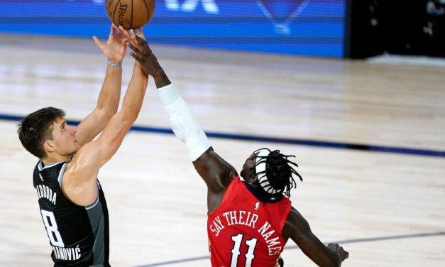 Sources: Bucks to acquire Holiday, Bogdanovic