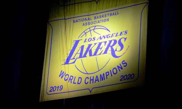 Lakers raise title banner, stay alive for top-6 spot