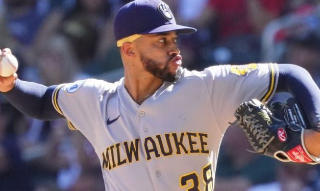 Brewers RP Williams punches wall, breaks hand