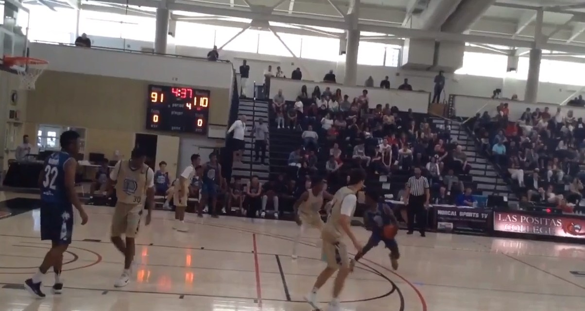 Absolutely Incredible Move  During a High School basketball Game
