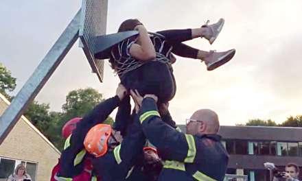 Team Rescues Girl Stuck in Basketball Hoop