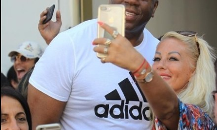 Magic Johnson Poses with Fans While Shopping in Beverly Hills