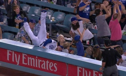 Dodgers First Baseman Falls into the Stands Going After a Foul Ball