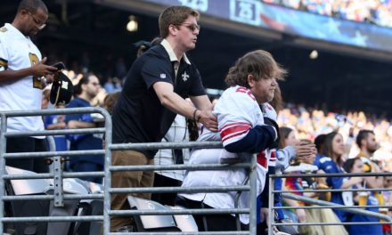 Saints Fan Spotted Helping a Disabled Giants Fan Stand for the National Anthem