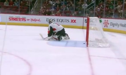 Goalie Lets a Shot from Beyond Center Ice Go Through His Legs and Into the Net