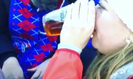 Bills Fan Takes a Fellow Passed Out Fan's Beer and Chugs It for Him