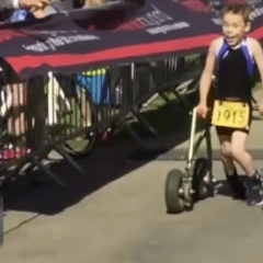 Eight-year-old casts aside frame to finish triathlon