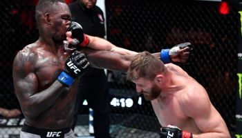 Jan Blachowicz throws a right punch on the nose of Israel Adesanya at UFC 259