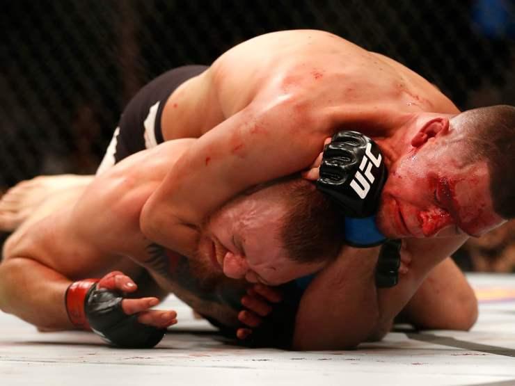 Nate Diaz putting McGregor in a rear choke hold