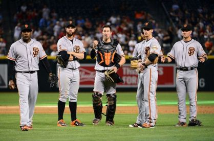 May 15, 2016; Phoenix, AZ, USA; (L-R) San Francisco Giants Santiago Casilla (46), Brandon Belt (9), Trevor Brown (14), Matt Duffy (5) and Joe Panik (12) react to the umpires overturning a double play after video review in the ninth inning against the Arizona Diamondbacks at Chase Field. The San Francisco Giants won 2-1. Mandatory Credit: Jennifer Stewart-USA TODAY Sports
