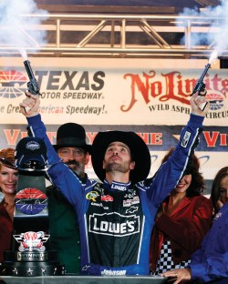 At the Texas Motor Speedway, NASCAR race winners traditionally fire six-shooters into the air. Photo by: Tim Sharp/AP Images