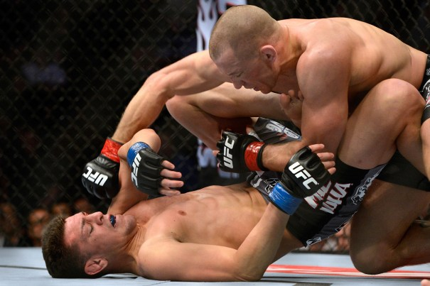Georges St-Pierre, right, is the reigning UFC welterweight champion and has won 11 matches in a row. In March, he defended his title against Nick Diaz, left, at  UFC 158 in Montreal, Canada. Photo by Eric Bolte/USA Today Sports