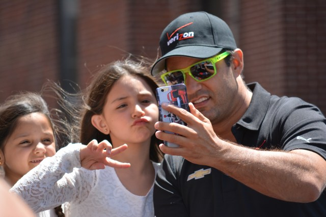 2015 Indy 500 winner Juan Pablo Montoya and his daughter joke around during the parade before the race.