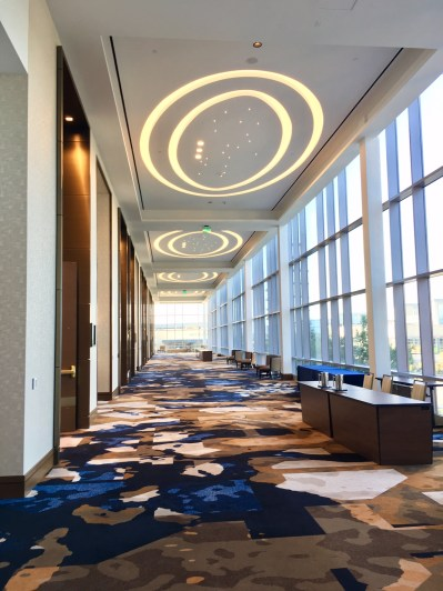 The Omni Frisco hotel's design elements, such as these lights shaped like footballs, pay homage to the Dallas Cowboys.