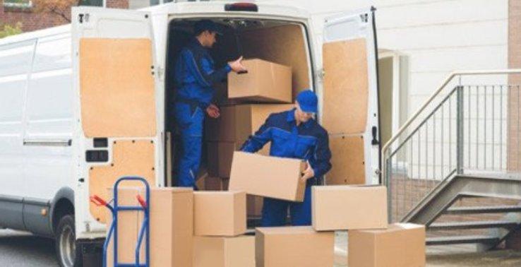 guy holding boxes