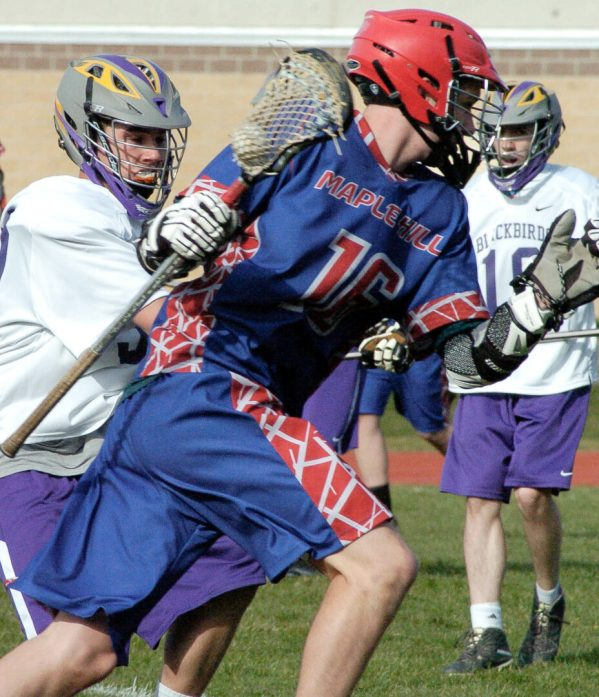 A Voorheesville player shadows Maple Hill's Liam Danaher during a Colonial Council game Wednesday, April 13. Rob Jonas/Spotlight