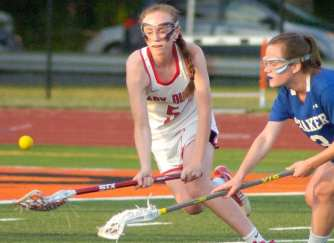 Guilderland's Kerry Gerety and Shaker's Kailey Dodd battle for a ground ball. Rob Jonas/Spotlight