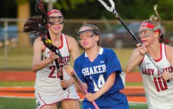 Shaker's Kayleigh Papa avoids contact with Guilderland's Courtney Rafferty. Rob Jonas/Spotlight