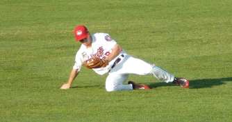 Tri-City center fielder Stephen Wrenn makes a sliding catch for the final out of the first inning. Rob Jonas/Spolight