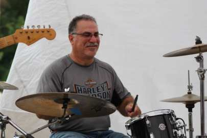 Christoper Garabedian playing drums for Emerald City