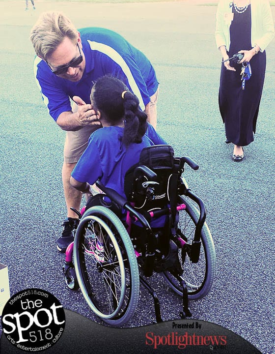 Kira Wall and her dad Peter celebrate after the race