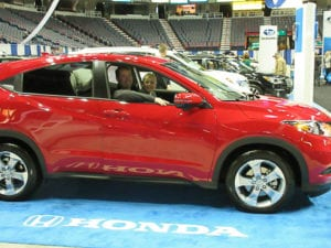 Albany Auto Show patrons take a seat in one of the Honda models on display at the 2015 show.  (Photo provided by ENYCAR, Inc.)