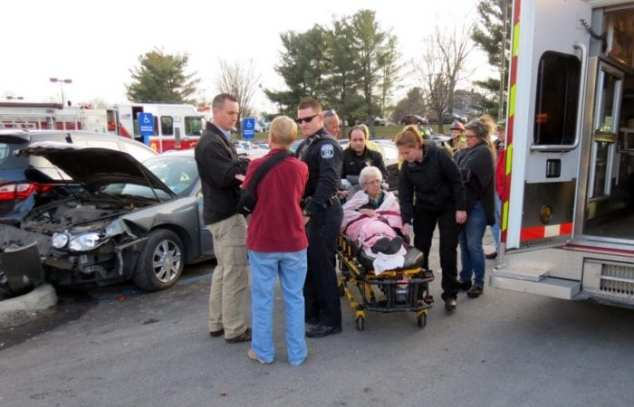 An elderly woman was taken to a local hospital after her vehicle crashed into several cars and utility trailers at Glenmont Plaza Monday, Dec. 26. Photo by Tom Heffernan Sr.