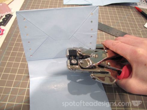 Turn an ordinary paper bag into a mini album. Inside a slot for a gift card and it becomes a unique gift wrapping idea! | spotofteadesigns.com
